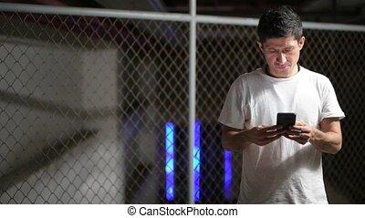 Hispanic man wearing casual clothing thinking while using ...