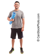 Hispanic man with a yoga mat