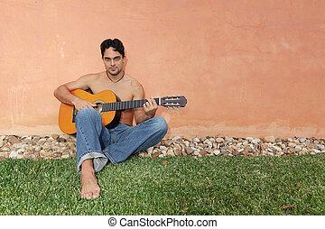 hispanic man with guitar