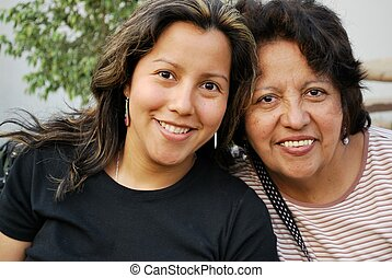 Hispanic middle aged mother and grown daughter