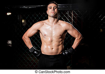 Hispanic MMA Fighter in a cage