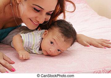 hispanic mother and her newborn baby