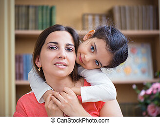 Hispanic mother and little daughter