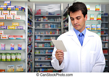 pharmacist reading prescription at pharmacy - hispanic...