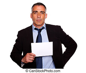 Hispanic senior business man holding a white card
