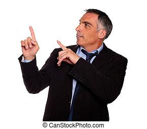 Hispanic senior entrepreneur pointing up