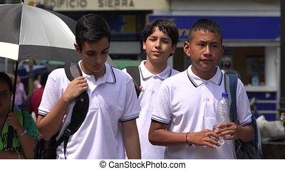 Hispanic Teen Boys Walking