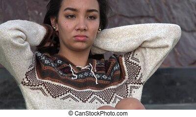 Hispanic Teen Girl Fixing Hair