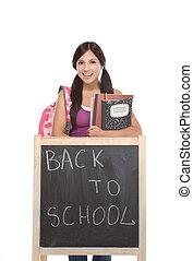 Hispanic teenager College student by blackboard