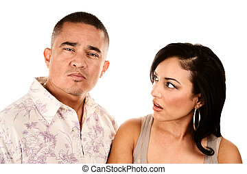 Hispanic wife looks suspiciously at her husband