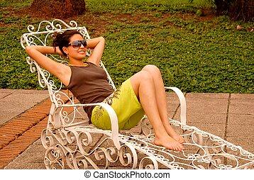 Hispanic woman by the pool