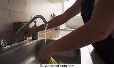 Hispanic Woman Cleaning Home