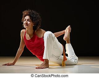 hispanic woman doing stretching and yoga