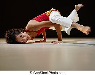 hispanic woman doing yoga exercise