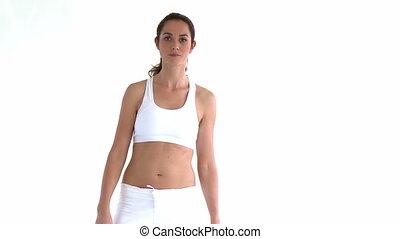Hispanic woman doing yoga pose