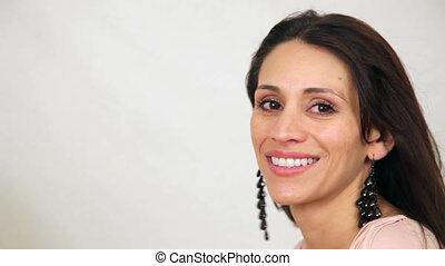 Hispanic Woman Hair Blowing in Wind