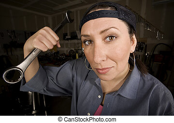 Hispanic woman in a agarage