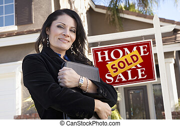 Hispanic Woman in Front of Real Estate Sign and New Home