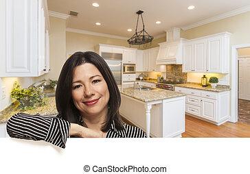 Hispanic Woman Leaning Against White In Custom Kitchen Interior