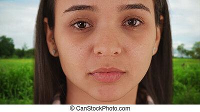 Hispanic woman looking at camera