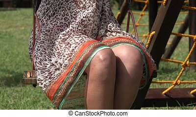 Hispanic Woman on Swing
