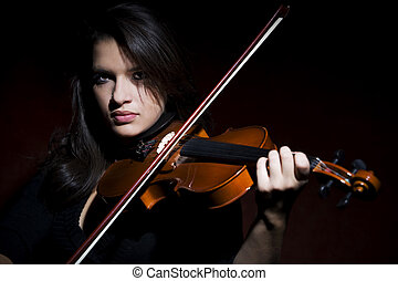 Hispanic woman playing violin