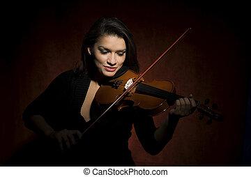 Hispanic woman playing violin - Pretty Hispanic woman in...