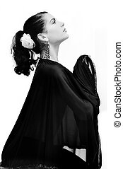 Hispanic woman praying - Portrait of young hispanic woman...