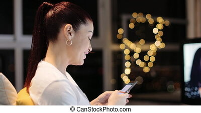 Hispanic Woman Sends Text Message Chats On Mobile Phone