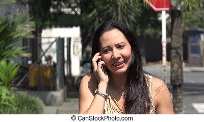 Hispanic Woman Talking on Mobile