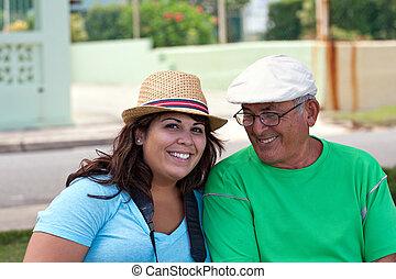 Hispanic Woman with Her Grandfather - A older Hispanic...