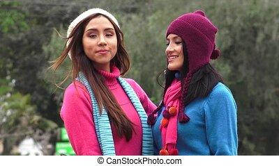 Hispanic Women Wearing Sweaters On Cold Day