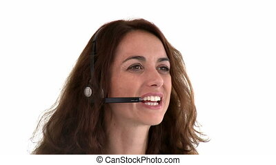 Hispanic working in a call-center with earpiece on against...