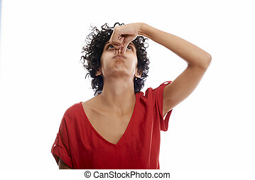 Hispanic young woman holding breath - Hispanic woman holding...