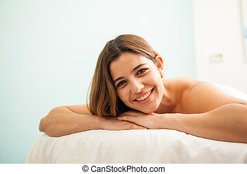 Hispanic young woman relaxing in a spa