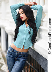 Hispanic young woman wearing casual clothes in urban...