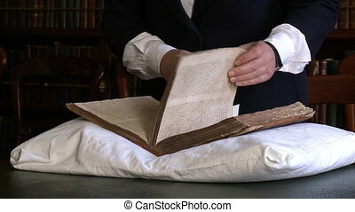 Historian flipping through pages of an old book