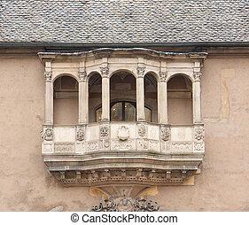 historic balcony seen on a house in Colmar, Alsace, France