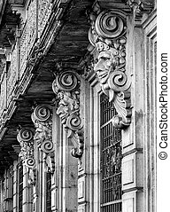 Historic building facade with masks