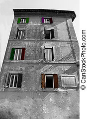 building in black and white with colored shutters