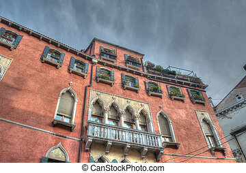 historic building in Venice under a dramatic sky