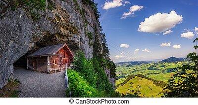 Historic cabin in the Wildkirchli cave in Switzerland