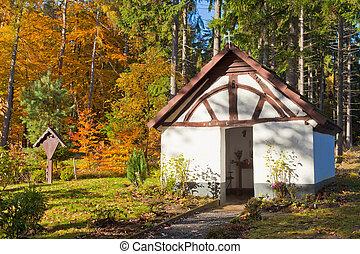 Historic Chapel in fall forest, Eifel, Germany