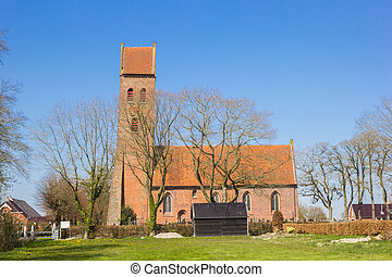 Historic church with leaning tower in Midwolde