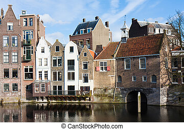Historic cityscape along a channel in Delfshaven, a district of Rotterdam, the Netherlands
