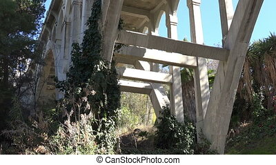 Historic Concrete Bridge - Tilt shot up a historic old...