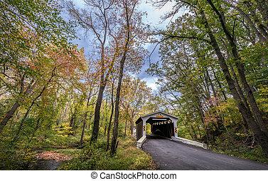 Historic Covered Bridge in rural Pennsylvania during Autumn