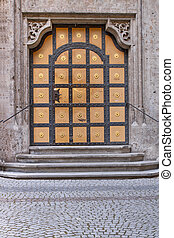 Historic door at the new town hall in Munich at night