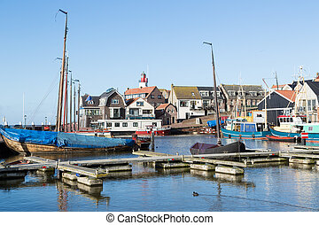 Historic Dutch harbor of Urk with lighthouse and old shipyard