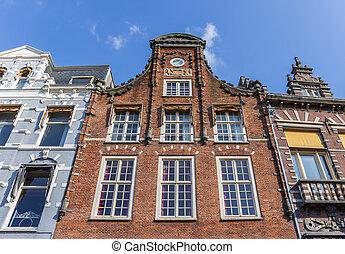 Historic facade at the main market square of Haarlem